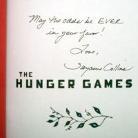 "Rare first edition, signed copy of ""The Hunger Games"" book on sale"